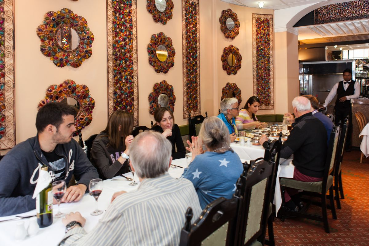 Diners at Delhi Brasserie Indian Restaurant in Soho London